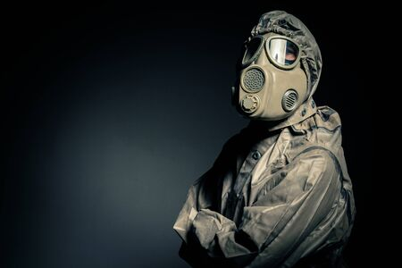 Man in protective suit against black background photo