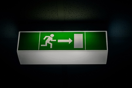 evacuate: Exit sign in the Dark in green