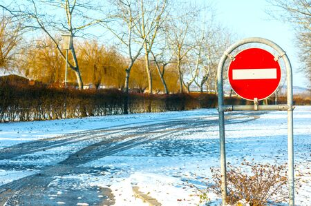 No entry sign at the road at winter photo