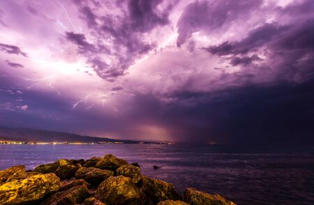 Storm at the beach with dramatic sky photo