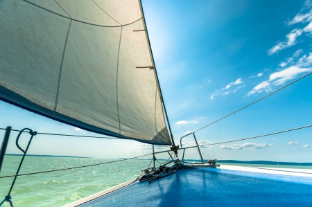 power boat: Sailing boat on the water in sunshine Stock Photo