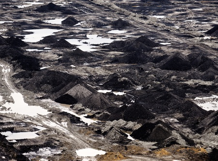 Industrial landscape of a working mine with black coal photo