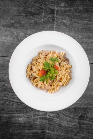 Delicious pasta on white plate closeup photo photo