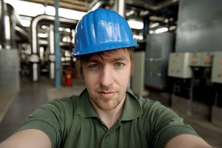 Young engineer in a power plant closeup photo photo