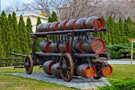 Beer transportation in wooden barrels outdoors photo