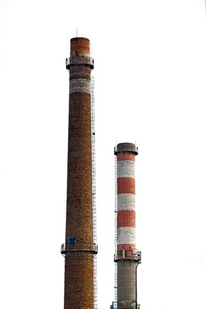 tall chimney: Tall industrial chimney against isolated white background Stock Photo