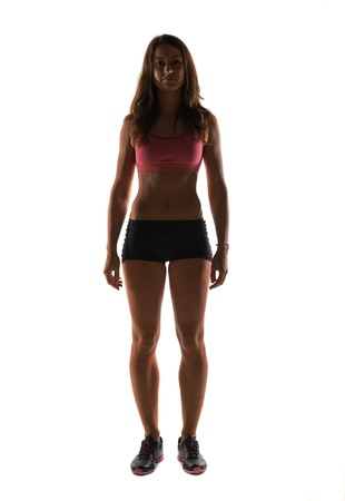 Silhouette Fitness instructor in a studio working out Stock Photo - 20793009