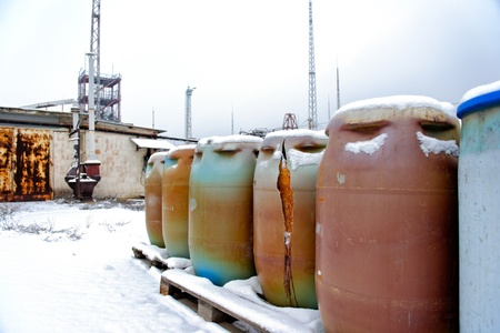 nuclear waste disposal: Photo of a Chemical waste dump with a lot of barrels Stock Photo