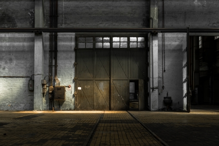 dirty room: Large industrial door in a factory