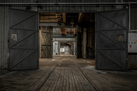 abandoned warehouse: Large industrial door in a factory