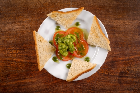 Healthy appetizer with  toast and gnocchi on the table photo