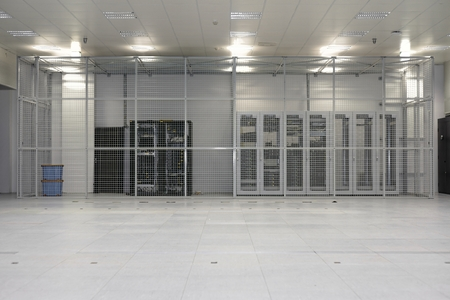 cage: Clean industrial interior of a server room with servers