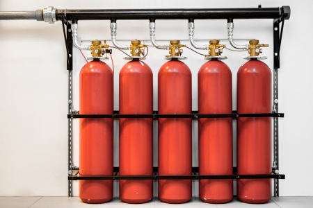 extinguishers: Large CO2 fire extinguishers in a room