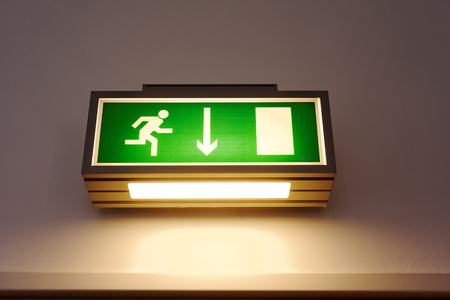 Exit sign on the wall photo