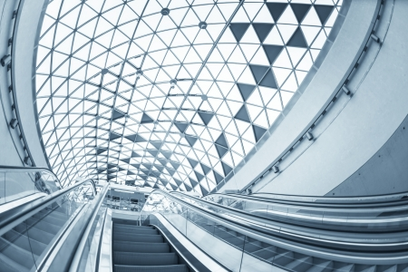 Moving escalator in the business center of a city Standard-Bild