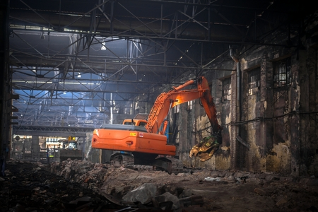 Large industrial interior with bulldozer inside photo
