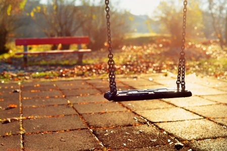 swing seat: Playground swing in a park Stock Photo