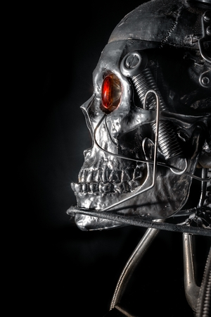 Skull of a human size robot isolated on black photo
