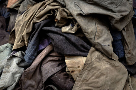 Dirty industrial clothes in a pile closeup photo