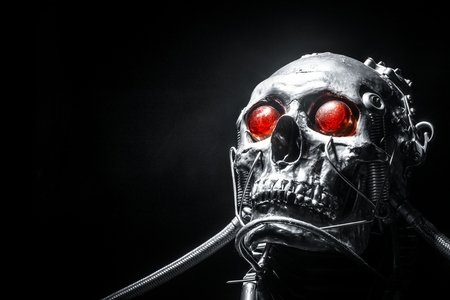 terminator: Skull of a human size robot isolated on black
