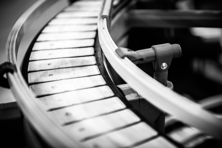 Small conveyor belt closeup photo in black and white