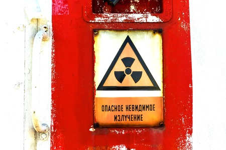 Radioactivity sign on a shelter door closeup photo