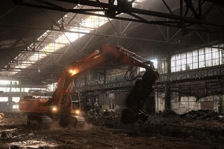 Large industrial interior with orange bulldozer inside photo