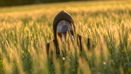 gasmask: Allergic man with gasmask at the field Stock Photo