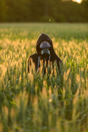 Allergic man with gasmask at the field photo