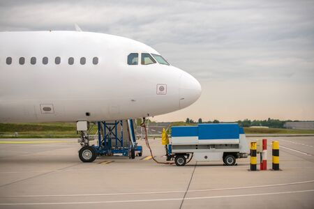 benzin: White cargo plane at airport refueling station Stock Photo