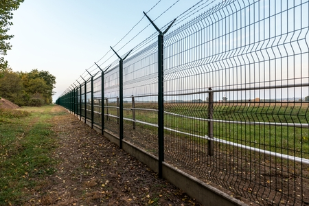 barbed wire fence: Private property in the forest angle shot