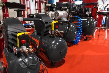 Many Air compressors pressure pumps  closeup photo