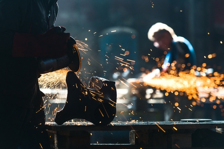 metal worker: Industrial Worker at the factory welding closeup