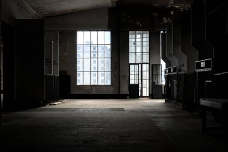 dark room: Dark and abandoned interior of a power plant Stock Photo