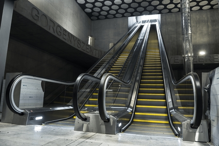 Moving escalator in the business center of a city photo