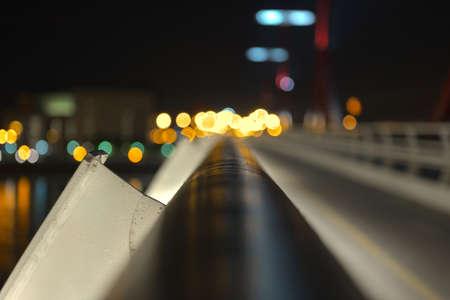 Empty bridge at night with lights closeup photo