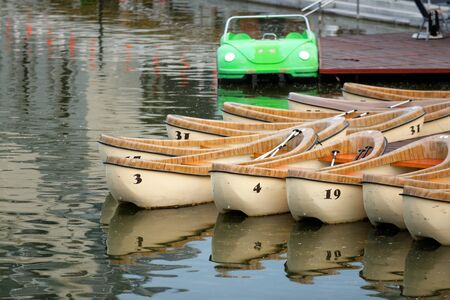 Wooden canoes for rent on the lake Stock Photo