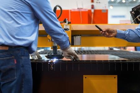 Machine cutting steel in a factory closeup photo