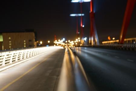 Empty bridge at night with lights photo photo