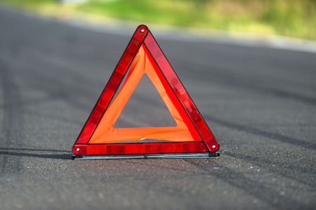 Red triangle of a car on the road Stock Photo