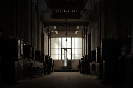 Dark and abandoned interior of a power plant photo