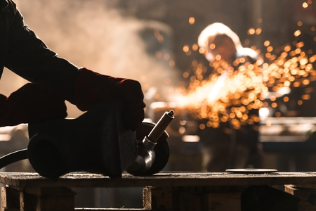 Industrial Worker at the factory welding closeup photo