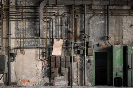 Industrial fuse boxes against damaged wall closeup Stock Photo - 34339532