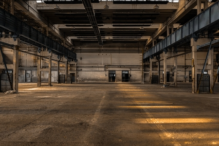 abandoned warehouse: Large industrial hall of a vehicle repair station