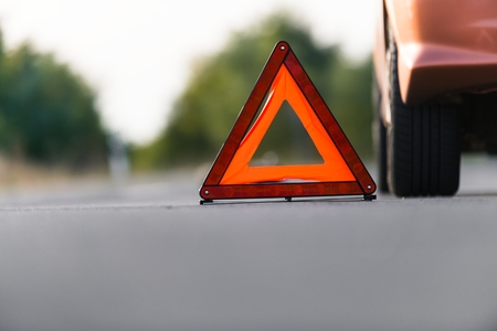 Red triangle of a car on the road photo