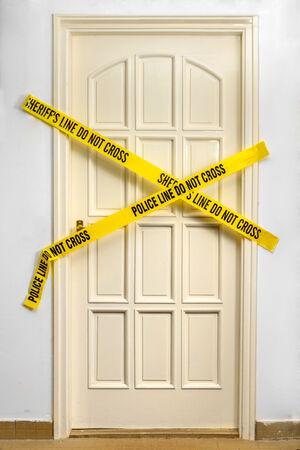 Yellow Plastic Crime Scene Do Not Cross Tape Stock Photo
