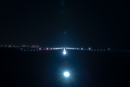 Landing lights at the airport runway at night