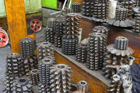 boring rig: Industrial drill bits stacked up on the shelf Stock Photo