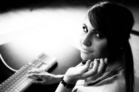 remote backup service: Woman sitting at helpdesk with keyboard closeup photo Stock Photo