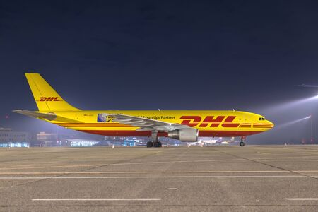 world market: BUDAPEST, HUNGARY - MARCH 5 - DHL Airbus A300 cargo plane at Budapest Airport, March 5th 2014. DHL is a world market leader in air mail Editorial